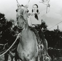 Image of Oak Lawn Round-Up Days - This photograph was taken at the Oak Lawn Round-Up Days.  The image shows Dorothy Olsen, secretary of the Chamber of Commerce, riding a horse.