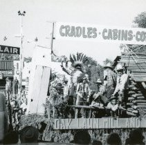 Image of Oak Lawn Round-Up Days Parade - This is a photograph of the Oak Lawn Round-Up Days parade on 95th Street near Cook Avenue.  Structures such as the Sinclair Service Station (left) can be seen in the background.