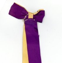 Image of Covington School Graduation Ribbon, 1952 - This item is a 1952 Covington School graduation ribbon.  It is purple and yellow in color with gold lettering.