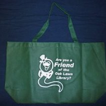 Image of Friends of the Oak Lawn Library Bag - This item is a bag given out by the Friends of the Oak Lawn Library.  The bag is green in color with white lettering and features an image of a worm.