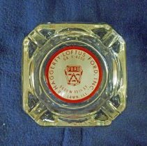 Image of Haggerty-Loftus Ford Ashtray - This item is an ashtray from Haggerty-Lotus Ford located at 5600 West 95th Street in Oak Lawn.  It is clear in color and features a red and white logo in the center.