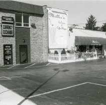 Image of A & B Oak Lawn Currency Exchange  - This is a photograph of the A & B Oak Lawn Currency Exchange which was located at 5112 West 95th Street. Millie's Ice Cream and Coffee Shoppe which was located at 5108 West 95th Street in the same building can be seen in the background.