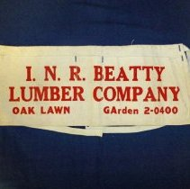 Image of I.N.R. Beatty Lumber Company Apron - This item is a tool apron from I.N.R. Beatty Lumber Company located at 9537 South 52nd Avenue in Oak Lawn.  It is white in color with red lettering and features two pockets.