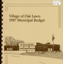 Image of Adopted Village Budget, 1987 - This item is the adopted 1987 budget for the Village of Oak Lawn.  The document is 162 pages long, has plain white paper, and a brown cover featuring a fire station.