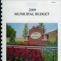 Image of Adopted Village Budget, 2009 - This item is the adopted 2009 budget for the Village of Oak Lawn. The document is 202 pages long, has plain white paper, and a white cover with the Village of Oak Lawn welcome sign.