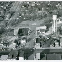 Image of Aerial Photograph of 95th Street and Cook Avenue Looking North - Aerial view of 95th Street and Cook Avenue looking north taken in 1957.  The Oak Lawn Public Library, Village Hall, Public Safety Building, Sinclair Service Station, water tower, Masonic Temple, Nick's Tap (formerly Schultz's Tavern) and other structures are visible.