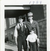 Image of Vallera Family - This is a photograph of the Vallera Family posing at 9515 South Kilpatrick Avenue.  From left to right are Lee, Sal Liberatore, and Urban.
