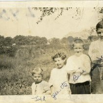 Image of Vallera Family - This is a photograph of the Vallera Family posing near 95th Street and Cicero Avenue.  From left to right are Grandma Vallera, Lydia, Jeanette, Bill, and Jim.