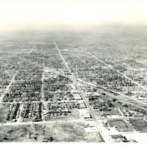 Image of Aerial Photograph Looking West Intersection of 95th and Cicero Avenue - Aerial view looking west at the intersection of 95th Street and Cicero Avenue in 1953.  The railroad can be seen crossing the photo diagonally.