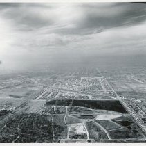 Image of Aerial Photograph near 87th Street (Pulaski Avenue) - Aerial photograph looking west along 87th Street from east of Crawford Avenue (now Pulaski) in 1953. St. Marys cemetery can be seen foreground and Southwest Highway is visible running at a diagonal.