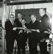 Image of 5th District Court Ribbon-Cutting - Photograph of Cook County 5th District Court ribbon-cutting ceremony taking place in Oak Lawn in 1965.  Left to right: Richard Ogilvie, Joseph McDonough, Mayor Fred M. Dumke, John S. Boyle, Judge Irving Eiserman.  The court was located next to the Oak Lawn Village Hall, and the Center of Public Safety is visible in the background.