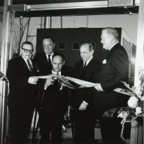 Image of 5th District Court Ribbon-Cutting - Photograph of Cook County 5th District Court ribbon-cutting ceremony taking place in Oak Lawn in 1965.  Left to right: Richard Ogilvie, Joseph McDonough, Fred M. Dumke, John S. Boyle, Judge Irving Eiserman.  The court was located next to the Oak Lawn Village Hall, and the Center of Public Safety is visible in the background.