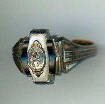 Image of Calumet High School Class Ring - This item is a class ring from Calumet High School that belonged to Oak Lawn resident Lydia Vallera.  It is bronze in color and features the image of a Native American.  Prior to the opening of the Oak Lawn High Schools, some local residents attended Calumet High.
