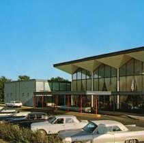 Image of Mid-America Inn Postcard - This item is a postcard from the Mid-America Inn located at 5001 West 79th Street.  The front has an image of the hotel while the back contains promotional information. Although the postcard lists the address as Oak Lawn the hotel was actually located in Burbank. The building was demolished around 2015.