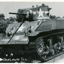 Image of Oak Lawn War Memorial Postcard - This item is a postcard of the Oak Lawn War Memorial on 95th Street.  The front has an image of an M-5 Stuart Tank while the back has minimal writing.  This tank was introduced into military service in 1941 and saw combat in the African and European Theaters of war.