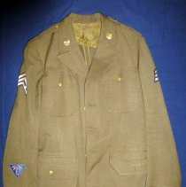 Image of John Lukacek WWII Army Air Force Uniform - This item is United States Army Air Force Uniform from World War II.  It was owned by Oak Lawn resident John Lukacek and features several different buttons and patches.