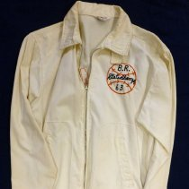 Image of John Lukacek Oak Lawn Baseball for Boys Jacket - This item is an Oak Lawn Baseball for Boys Jacket owned by resident John Lukacek.  It is white and orange in color and was created in 1963 to celebrate the State Championship.  That year the team went on to participate in the World Series held in New Mexico.