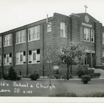 Image of St. Gerald School and Church Postcard - This item is a postcard of St. Gerald School and Church in the 1940s.  The front has an image of the building while the back has a small amount of information.