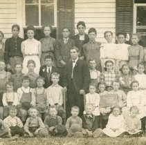 Image of Simmons School Postcard - This item is a postcard of Simmons School.  The front has an image of the school's students while the back is blank.
