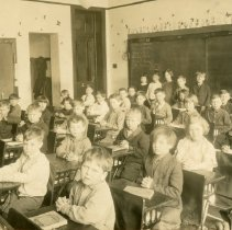 Image of Cook School Class Postcard - This item is a postcard of the second grade class in Cook School located at 9526 South Cook Avenue.  The front has an image of the class while the back contains a small amount of written information.