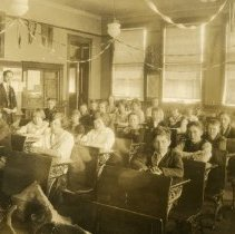 Image of Cook School Class Postcard - This item is a postcard of the eighth grade class at Cook School located at 9526 South Cook Avenue. The front shows students and teacher Wiley Simmons while the back has general information.