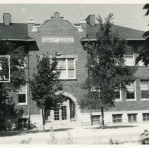 Image of Cook School Postcard - This item is a postcard of Cook Avenue School located at 9526 South Cook Avenue.  The front has an image of the building while the back has no information.