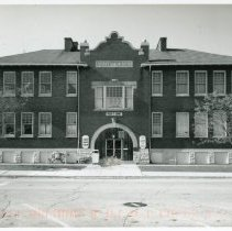 Image of Cook School Postcard - This item is a postcard of Cook Avenue School located at 9526 South Cook Avenue.  At the time, the building was being used as the Oak Lawn Family Service Center.  The front has an image of the building while the back has some written information.