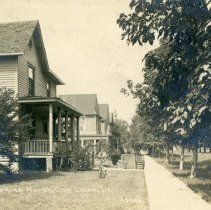 Image of Cook Avenue Postcard - This item is a postcard of Cook Avenue looking north in 1910.  There are several homes visible and the back has a personal message written on it.