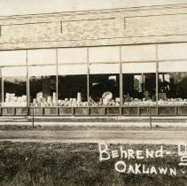 Image of Behrend's Hardware Store Postcard - This item is a postcard of Behrend's Hardware store located on 95th Street.  The front has an image of the building while the back has a small amount of written information.