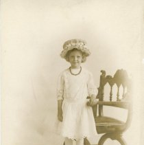 Image of Hazel Phillips Bryson Postcard - This item is a postcard of Hazel Phillips Bryson posing for a portrait in her sunday school dress around 1909.  There is a small amount of written information on the back.