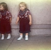 Image of Twin Girls at Round-Up - Twin girls (Beth-left, Bella-right) at Round-Up, Sept 19, 1950. The twin girls are related to Ray Eldridge, owner of the Paint and Wallpaper store in Oak Lawn.
