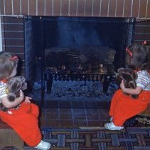 Image of Twin Girls Staring at the Fireplace    - Twin girls, Beth and Bella, staring at the fireplace.  This image may have been photographed at Ray Eldridge's home in Oak Lawn.