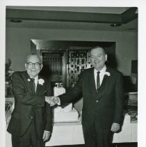 Image of 75th Anniversary of Oak Lawn Trust and Savings - This is a photograph of F. McDonald and Robert McDonald at the celebration of the 75th anniversary of Oak Lawn Trust and Savings Bank.  The bank merged with the First National Bank of Evergreen Park in 1992 and no longer exists today.