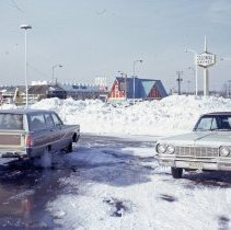 Image of 1967 Snowstorm - This is a photograph of the 1967 snowstorm.  It looks north toward the intersection of 95th Street and Cicero Avenue.  White Castle, Colonial Savings, Quality Chevrolet, and other businesses are visible.