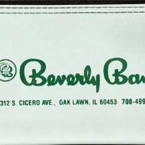 Image of Beverly Bank Deposit Bag - This item is a deposit bag from Beverly Bank located at 10312 South Cicero Avenue in Oak Lawn.  It is gray and green in color and features the bank's logo.
