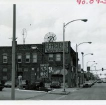 Image of 5100 West Block of 95th Street - This is a photograph of the 5100 block of 95th street focusing on the south side.  Brandt's Tavern (located at 5131 West 95th Street), S&S Men's Wear (5213 West 95th Street), and other businesses are visible.  A promotional sign for the Oak Lawn Trust and Savings Bank is visible toward the top.