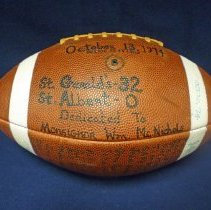 Image of St. Gerald Football  - This item is a football from St. Gerald School.  It features the signatures of numerous players and is dedicated to Monsignor William McNichols.  St. Gerald defeated St. Albert 32-0 in October of 1974.
