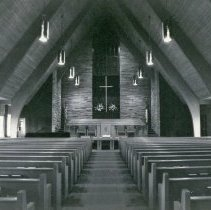 Image of Southwest Christian Missionary Alliance - This is a photograph of Southwest Christian Missionary Alliance formerly located at 9535 South Kildare Avenue. This image focuses on the center aisle looking toward the altar.