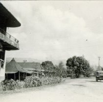 Image of World War II Photograph - This is a photograph taken in the Pacific Theater during the Second World War. It features a lone car and a large building, and may have been snapped in Japan or the Philippine Islands.