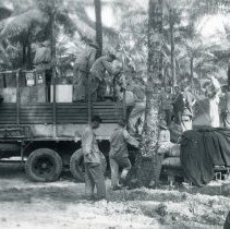 Image of World War II Photograph - This is a photograph taken in the Pacific Theater during the Second World War. It features a group of soldiers unloading a truck, and may have been snapped in the Philippine Islands.