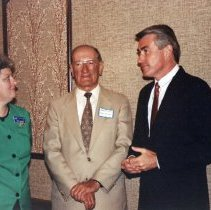 Image of Secretary of the State of Illinois Jim Edgar's Visit to the Oak Lawn Library - This is a photograph taken when Secretary of State Jim Edgar visited the Oak Lawn Public Library. From left to right: Director of the Oak Lawn Public Library Joy Kennedy, Mayor of Oak Lawn Ernie Kolb, and Secretary of the State of Illinois Jim Edgar.
