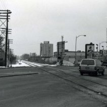 Image of 95th Street at the intersection of the train tracks (5000 West Block) - This photograph shows 95th Street at the intersection of the railroad tracks (5000 block), looking northeast. Shown in the photo are the Hilton Hotel and Max Madsen Mitsubishi.