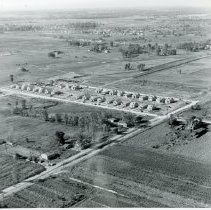 """Image of Aerial Photograph of Jolly Homes on Kostner Avenue - This is an aerial photograph of the """"Jolly Homes"""" on 107th Street and Kostner Avenue. The image shows homes as well as surrounding farmland."""