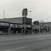 Image of 95th Street between 52nd Avenue and Cook Avenue - This is a photograph of businesses between 52nd Avenue and Cook Avenue on the south side of 95th Street in 1992. Shown in the image are: Rupich's Drugs, Oak Lawn Office Supply, S&S Men's Wear, Madewell Draperies.
