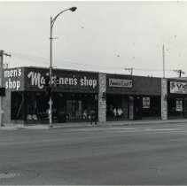 Image of Southwest Corner of 95th Street and 52nd Avenue - This is a photograph of businesses on the southwest corner of 95th Street and 52nd Avenue in 1992. Shown in the image are: Mal's Men's Shop, Annie's Ltd., Video King.
