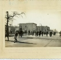 Image of Veteran's Day Parade, 1939 - This is a photograph of the Armistice Day (Veteran's Day) Parade in 1939. This image shows soldiers parading east on 95th Street.