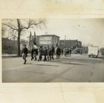 Image of Veteran's Day Parade, 1939 - This is a photograph of the Armistice Day (Veteran's Day) Parade in 1939. This image shows a Boy Scout troop parading east on 95th Street.