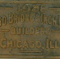 Image of Chicago Bridge and Iron Works Plaque - This item is a plaque from the first Oak Lawn Water Tower located near 95th Street and Cook Avenue.  The tower was constructed by Chicago Bridge and Iron Works in 1928 and remained in use until the 1970s.  There is a small white tag listing a number provided by the Oak Lawn Historical Society.