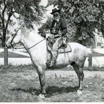 Image of Oak Lawn Round-Up Days, 1952 - This is a photograph from the Oak Lawn Round-Up Days in 1952. This image shows a man on a horse.