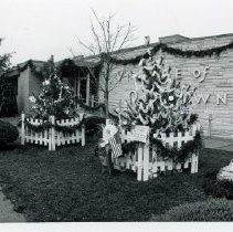Image of Village Hall with Christmas Decorations, 1987 - This is a photograph of the Oak Lawn Village Hall and Circuit Court of Cook County District 5.  This image shows the exterior of the building with Christmas decorations.